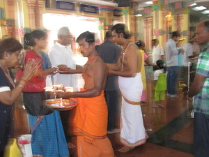 Inside the Hindu temple having a blessing
