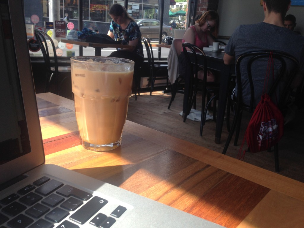 Iced coffee and laptop - a very liveable city!