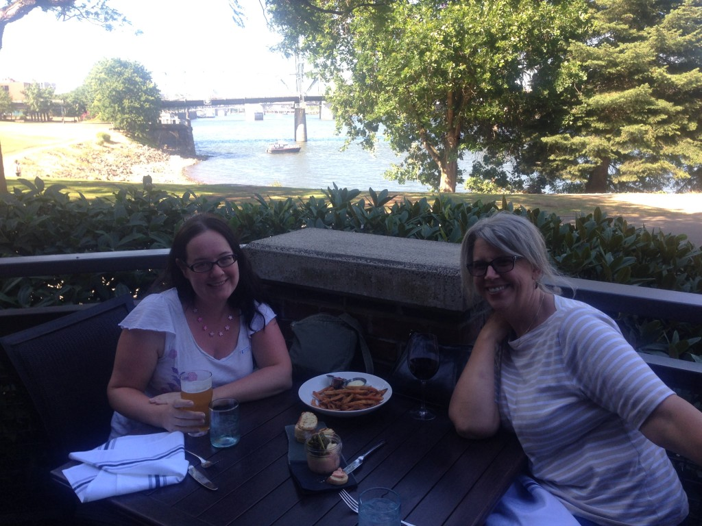 Enjoying happy hour with my friend by the river