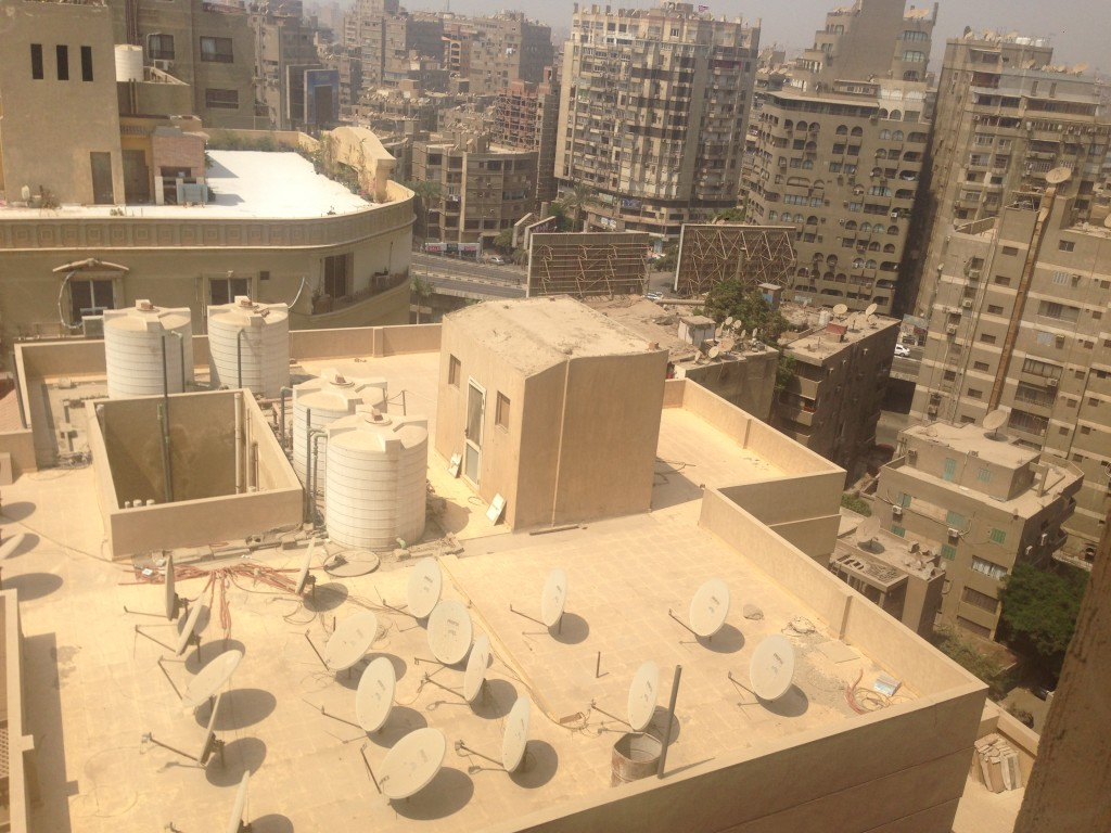 Satellite dishes mushroom from every roof in Cairo
